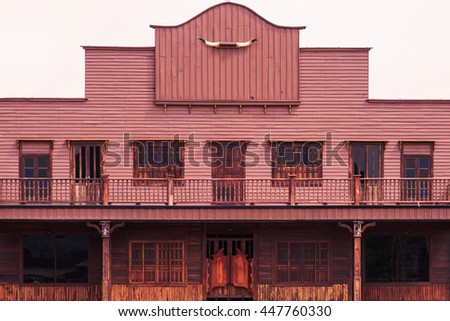 Old Wild West desert cowboy town with saloon - stock photo
