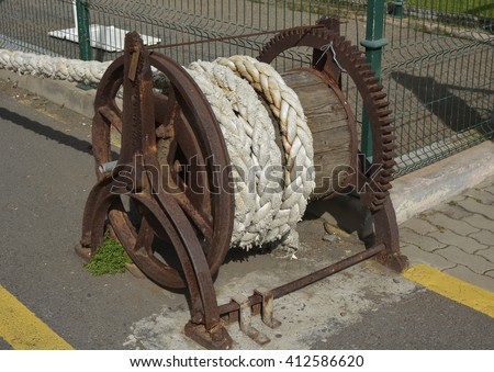 Old winch on seafront in Funchal, Madeira, Portugal - stock photo