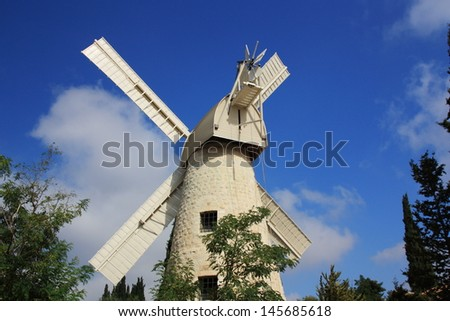Old Windmill at Mishkenot Sha�ananim , the first Jewish neighborhood outside the Old City in Jerusalem - stock photo