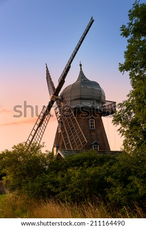 Old windmill Drottningen near the town Faerjestaden, on the island Oeland, Sweden. - stock photo