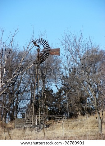 old windmill in bare trees