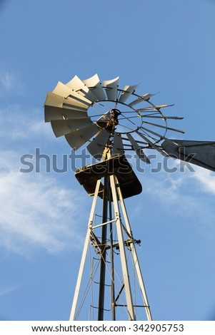 Old Windmill standing at the Leo Carrillo Park in Carlsbad, California with a beautiful blue sky as a backdrop
