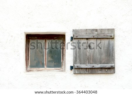 Old window and shutter in an Austrian castle wall - stock photo