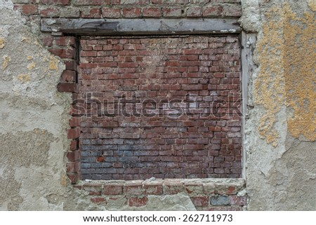 Old window covered with red bricks