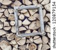 old window frame on the firewood pile - stock photo