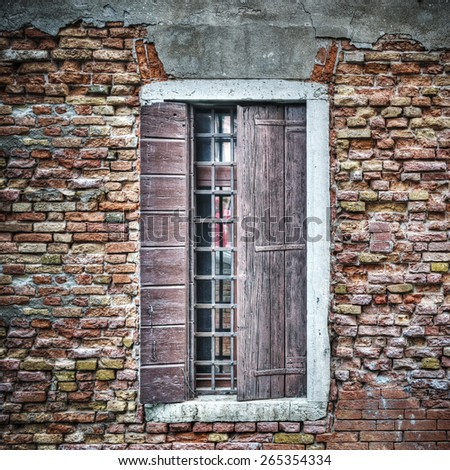 old window in a brick wall in Venice, Italy - stock photo