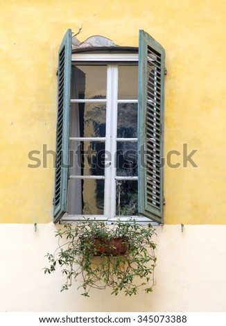 Old window in Lucca, Italy - stock photo