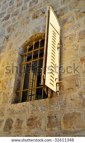 Old window in stone wall at Yamin Moshe  first neighborhood outside Old Jerusalem Walls