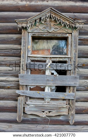 old window in the permitted wooden house - stock photo