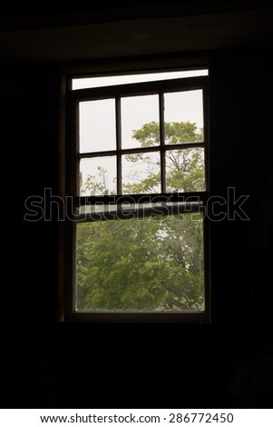Old Window inside an Abandoned Home - stock photo