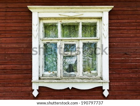 Old window of a wooden house