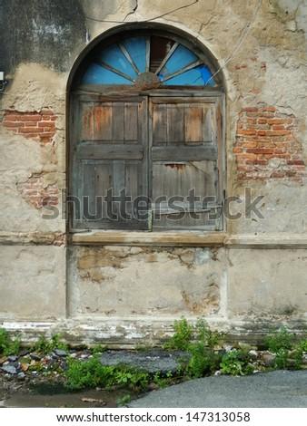 old  window of brick building - stock photo