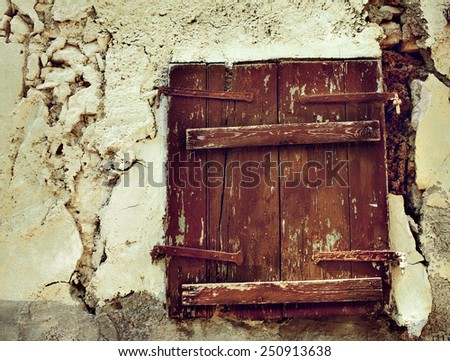 old window on the yellow wall - stock photo