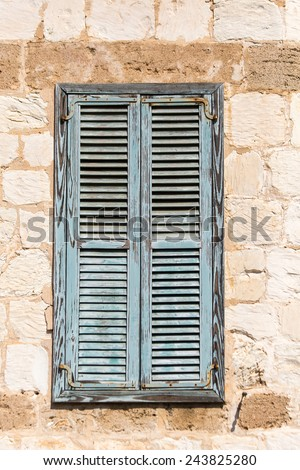 old window shutter, on a brick wall - stock photo