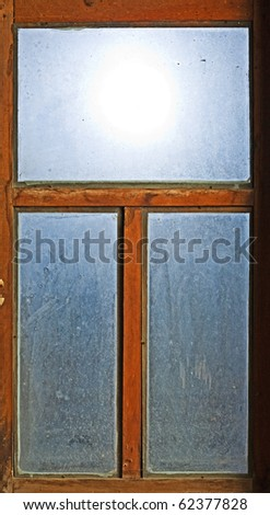 old window with blue glass