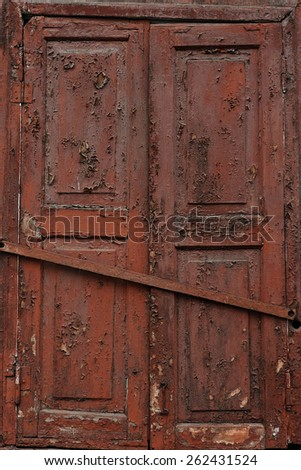 old window with burgundy shutters closed - stock photo