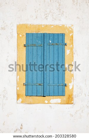Old window with closed shutters - stock photo