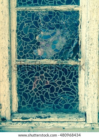 old window with mosaic in retro style