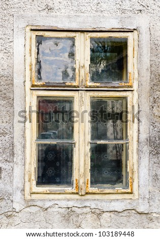 Old window with peeling paint