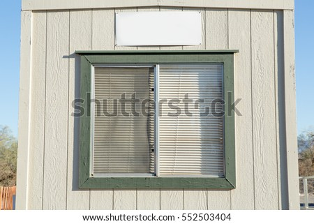 Old Window With Plastic Window Blinds On Wood Walls