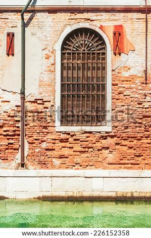 Old window with rusty iron bars, Venice Italy. - stock photo