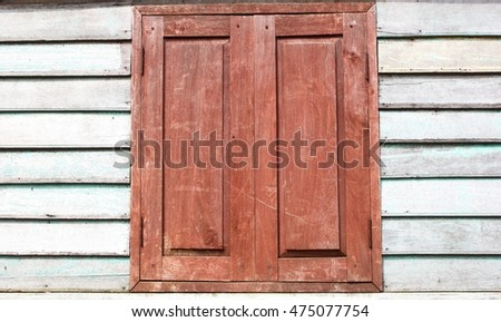 Old window with  Shabby Wooden Planks with cracked color Paint, background