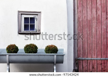 old window with white wall and a door at the right - stock photo