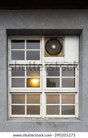 Old windows and ventilation fan.