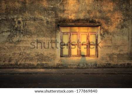 Old windows frame on the old cement wall - stock photo