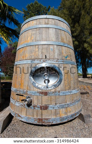 Old wine barrel for storage sits outside unused - stock photo