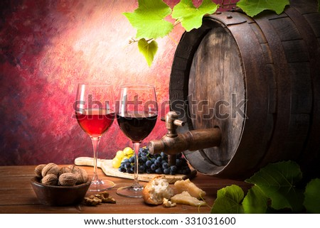 Old wine barrel with two glasses of wine - stock photo