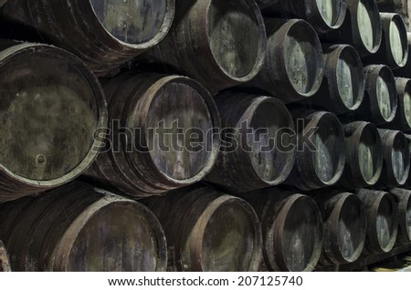 Old wine barrels in black and white. - stock photo