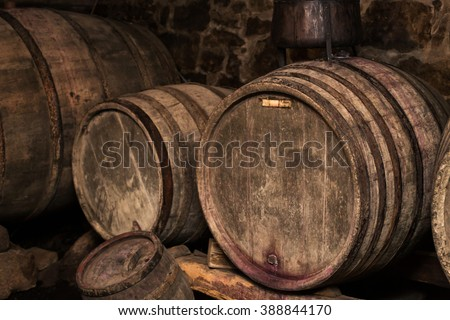 old wine barrels inside winery
