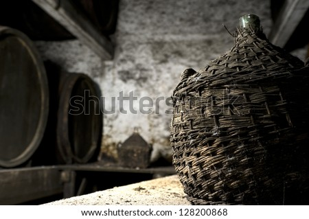 Old wine cellar. Old dusty and moldy wine cellar in an abandoned winery - stock photo