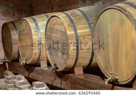 Old wine cellar with oak barrels equipment for wine production on brick wall background. & Old Wine Cellar Oak Barrels Equipment Stock Photo (100% Legal ...