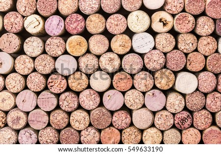 Old wine corks arranged in a background pattern