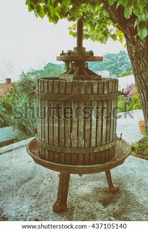 Old wine press. Vintage and retro toning - stock photo