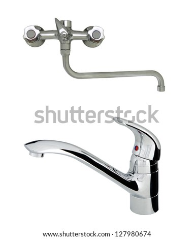 old with modern stainless steel tap - stock photo