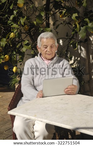 old woman and tablet