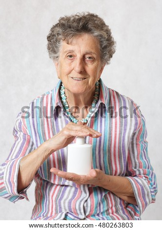 Old woman between 70 and 80 years old with a plastic box of intimate gel