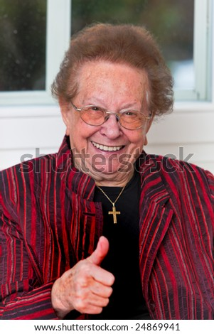 Old woman celebrates your success - stock photo