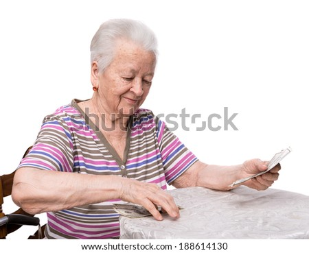 Old woman counting money on a white background