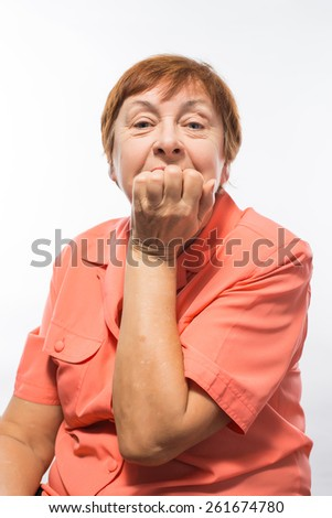 old woman covering her mouth with her hand - stock photo