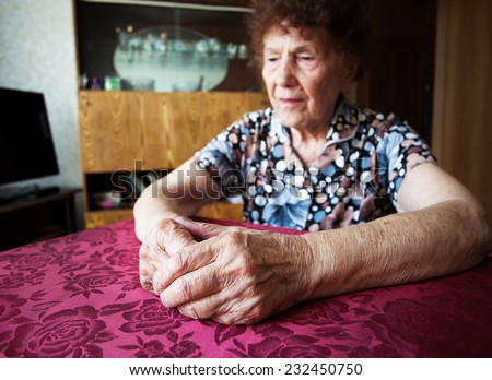 Old woman. Elderly sad female at home - stock photo