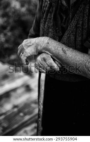 old woman hand close-up in black and white - stock photo