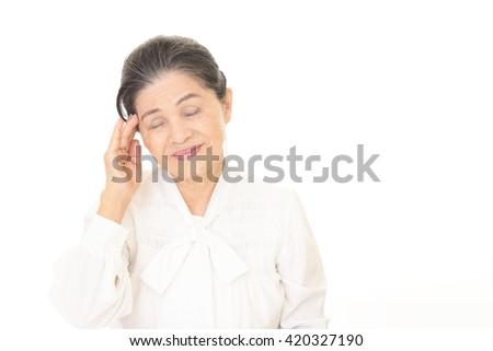Old woman having a headache - stock photo