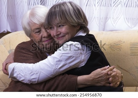 Old woman hugging with daughter - stock photo