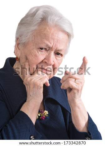 Old woman in angry gesture on white background - stock photo