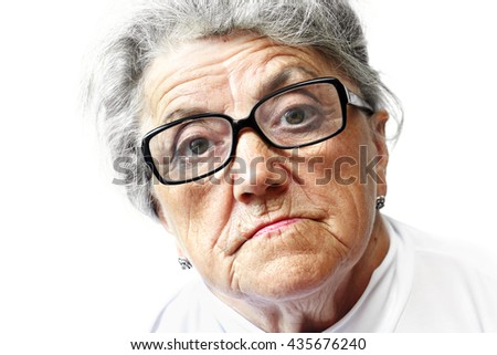 Old woman in glasses - stock photo
