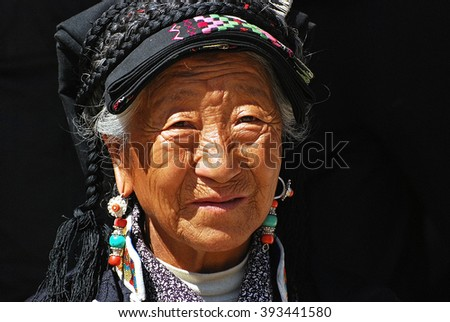 Old woman in Labrang monastery, January 6, 2015, China Tibet - stock photo